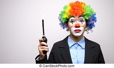 Conceptual clown in business suit firing a lighter