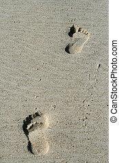 Conceptual footprints on a beach