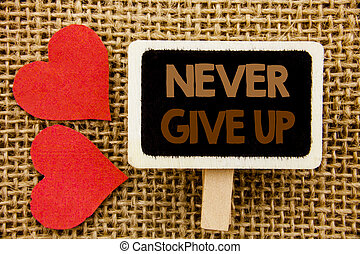 Conceptual hand text showing Never Give Up. Business photo showcasing Motivation Quote For Success Achievement Challenge written on blackboard on the textured background with Love Heart