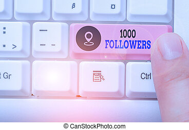 Conceptual hand writing showing 1000 Followers. Business photo showcasing number of individuals who follows someone in Instagram.