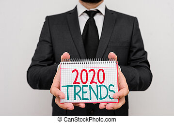 Conceptual hand writing showing 2020 Trends. Concept meaning things that is famous for short period of time in current year