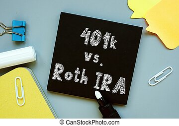 Conceptual hand writing showing 401k vs. Roth IRA.