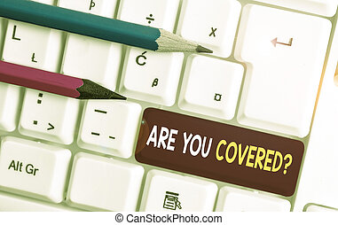 Conceptual hand writing showing Are You Covered Question. Business photo text asking someone or patient if he have insurance White pc keyboard with note paper above the white background.