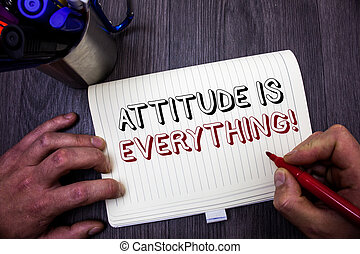 Conceptual hand writing showing Attitude Is Everything. Business photo showcasing Personal Outlook Perspective Orientation Behavior Man hold holding red marker notebook table messages ideas.