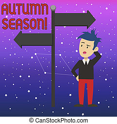Conceptual hand writing showing Autumn Season. Business photo text it is the season after summer, when leaves fall from trees Man Confused with Road Sign Pointing to Opposite Direction.