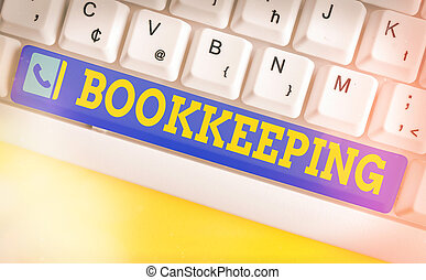 Conceptual hand writing showing Bookkeeping. Business photo text keeping records of the financial affairs of a business Colored keyboard key with accessories arranged on empty copy space.