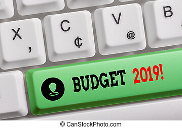 Conceptual hand writing showing Budget 2019. Business photo text the estimate of income and expenditure for current year Keyboard with note paper on white background key copy space.