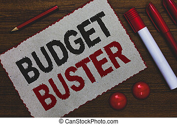 Conceptual hand writing showing Budget Buster. Business photo showcasing Carefree Spending Bargains Unnecessary Purchases Overspending White paper red borders markers pencils wooden background.