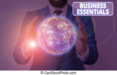 Conceptual hand writing showing Business Essentials. Business photo showcasing important key ideas to improve business skills Elements of this image furnished by NASA.