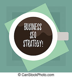 Conceptual hand writing showing Business Seo Strategy. Business photo text Optimization of website to rise the number of visits Top View of Drinking Cup Filled with Beverage on Color Paper.