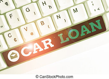 Conceptual hand writing showing Car Loan. Business photo showcasing taking money from bank with big interest to buy new vehicle White pc keyboard with note paper above the white background.