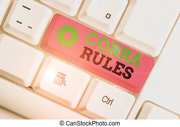 Conceptual hand writing showing Cobra Rules. Business photo text continuing group health insurance coverage after a job loss White pc keyboard with note paper above the white background.