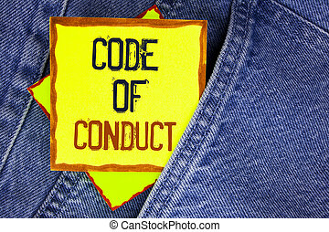 Conceptual hand writing showing Code Of Conduct. Business photo showcasing Follow principles and standards for business integrity written on Yellow Sticky Note Paper on the Jeans background.