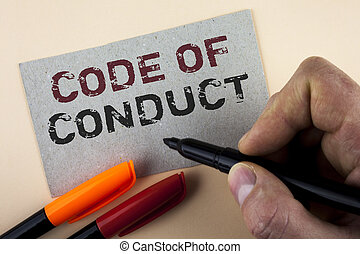 Conceptual hand writing showing Code Of Conduct. Business photo text Follow principles and standards for business integrity written by Man with Marker on Cardboard Piece on plain background