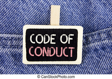 Conceptual hand writing showing Code Of Conduct. Business photo text Follow principles and standards for business integrity written on Wood Piece on the Jeans background.