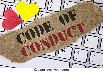 Conceptual hand writing showing Code Of Conduct. Business photo text Follow principles and standards for business integrity written on Tear Cardboard Piece placed on the Laptop Hearts.