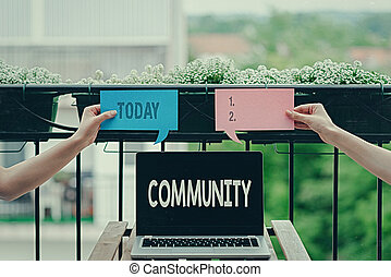 Conceptual hand writing showing Community. Business photo ...