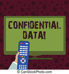 Conceptual hand writing showing Confidential Data. Business photo showcasing term that typically represents them as classified Hand Holding Remote Control infront of Wide Color PC Screen.