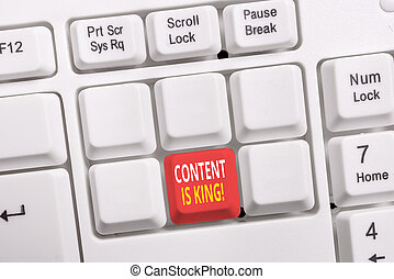 Conceptual hand writing showing Content Is King. Business photo showcasing marketing focused growing visibility non paid search results White pc keyboard with note paper above the white background.