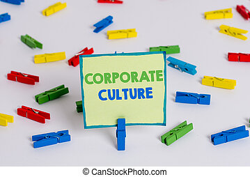 Conceptual hand writing showing Corporate Culture. Concept meaning pervasive values and attitudes that characterize a company Colored clothespin papers empty reminder white floor office