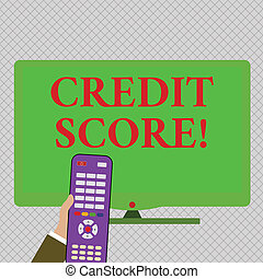 Conceptual hand writing showing Credit Score. Business photo text numerical expression based on level analysis of demonstratings files Hand Holding Remote Control infront of Wide Color PC Screen.