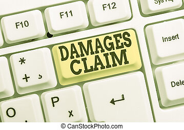 Conceptual hand writing showing Damages Claim. Business photo text Deanalysisd Compensation Litigate Insurance File Suit White pc keyboard with note paper above the white background.