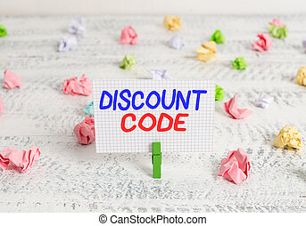 Conceptual hand writing showing Discount Code. Business photo text Series of letters or numbers that allow you to get a discount Green clothespin white wood background reminder office supply.
