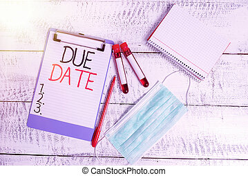 Conceptual hand writing showing Due Date. Business photo showcasing the day or date by which something is supposed to be done or paid Blood sample vial medical accessories ready for examination.