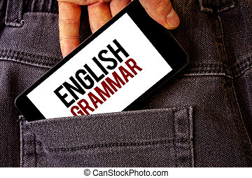 Conceptual hand writing showing English Grammar. Business photo showcasing Language Knowledge School Education Literature Reading Man holding cell phone white screen letters on jeans pocket.