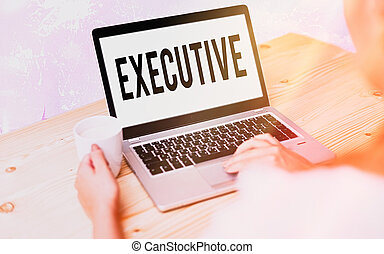 Conceptual hand writing showing Executive. Concept meaning belonging to the branch of government that is charged with powers Modern gadgets white screen under colorful bokeh background