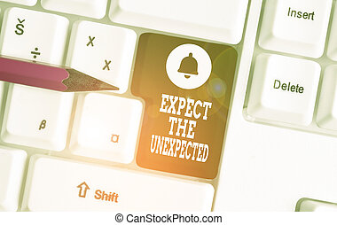 Conceptual hand writing showing Expect The Unexpected. Business photo showcasing Anything can Happen Consider all Possible Events White pc keyboard with note paper above the white background.