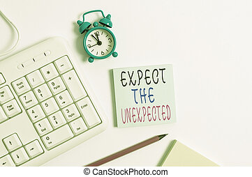 Conceptual hand writing showing Expect The Unexpected. Business photo showcasing Anything can Happen Consider all Possible Events Keyboard with empty note paper and pencil white background.