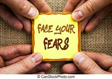 Conceptual hand writing showing Face Your Fears. Business photo showcasing Challenge Fear Fourage Confidence Brave Bravery written on Sticky Note Paper Holding Hand with Finger.