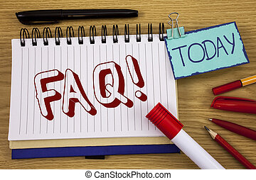 Conceptual hand writing showing Faq Motivational Call. Business photo text Frequently asked question for clearing up confusions written on Noteoad on wooden background Today Pen Pencil next to it