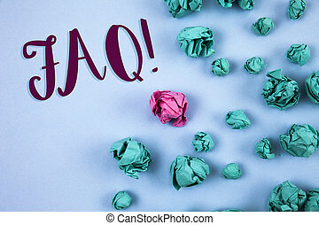 Conceptual hand writing showing Faq Motivational Call. Business photo text Frequently asked question for clearing up confusions written on Plain Blue background Paper Balls next to it.