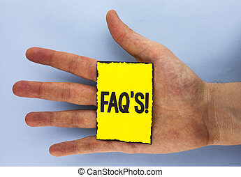 Conceptual hand writing showing Faq'S Motivational Call. Business photo showcasing Multiple questions answered for online product written on Yellow Sticky Note Paper on plain background Hand.