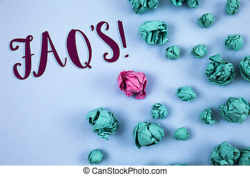 Conceptual hand writing showing Faq'S Motivational Call. Business photo text Multiple questions answered for online product written on Plain Blue background Paper Balls next to it.