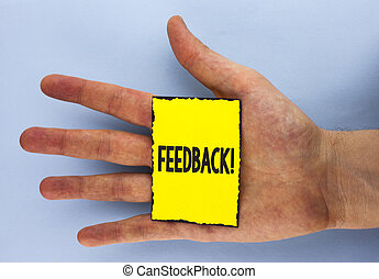 Conceptual hand writing showing Feedback Motivational Call. Business photo showcasing Rating an economical local grocery store written on Yellow Sticky Note Paper on plain background Hand.