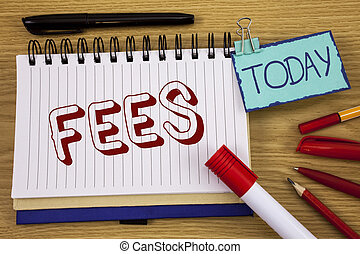 Conceptual hand writing showing Fees. Business photo text Online creative agency charges product components hourly costs written on Noteoad on wooden background Today Pen Pencil next to it
