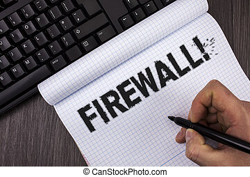 Conceptual hand writing showing Firewall Motivational Call. Business photo text Malware protection prevents internet frauds written by Marker in Hand on Notebook on wooden background Keyboard