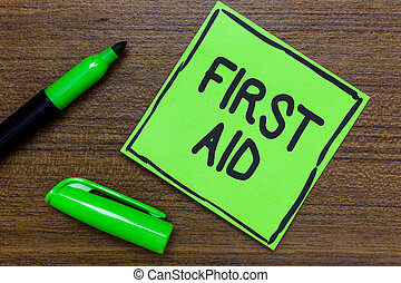 Conceptual hand writing showing First Aid. Business photo...