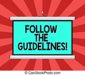 Conceptual hand writing showing Follow The Guidelines. Business photo showcasing Pay attention to general rule, principles or advice Portable Wall Projection Screen for Conference Presentation.