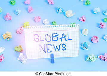 Conceptual hand writing showing Global News. Business photo showcasing world noteworthy information about recent or important events Colored crumpled papers empty reminder blue floor clothespin.