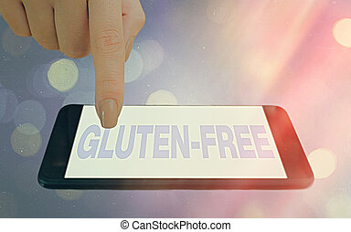 Conceptual hand writing showing Gluten Free. Concept meaning excludes the tenacious elastic protein substance of wheat flour Modern gadgets white screen under colorful bokeh background