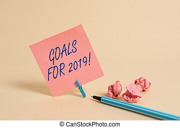 Conceptual hand writing showing Goals For 2019. Business photo showcasing object of demonstratings ambition or effort aim or desired result.