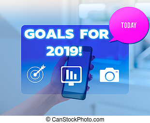 Conceptual hand writing showing Goals For 2019. Business photo text object of demonstratings ambition or effort aim or desired result woman smartphone speech bubble office supplies technology.