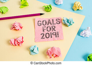 Conceptual hand writing showing Goals For 2019. Business photo text object of demonstratings ambition or effort aim or desired result Colored crumpled papers empty reminder blue yellow clothespin.