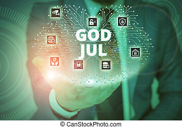 Conceptual hand writing showing God Jul. Business photo showcasing Merry Christmas Greeting showing for new year happy holidays Male wear formal suit presenting presentation smart device.