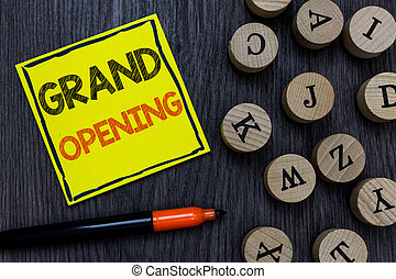 Conceptual hand writing showing Grand Opening. Business photo showcasing Ribbon Cutting New Business First Official Day Launching Yellow paper circle Marker express ideas wooden background.