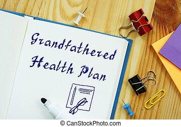 Conceptual hand writing showing Grandfathered Health Plan.